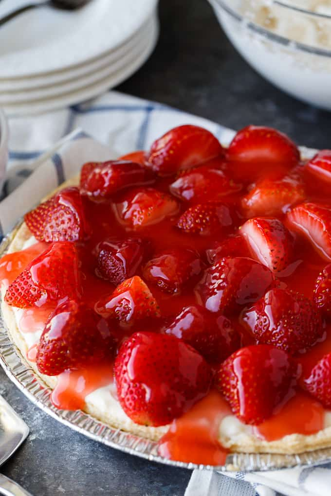 Strawberry Satin Pie - A beloved vintage summer pie that is worth the extra effort. Layers of toasted almonds, creamy and sweet vanilla filling and luscious strawberries enveloped in a shiny glaze make this dessert a huge hit.