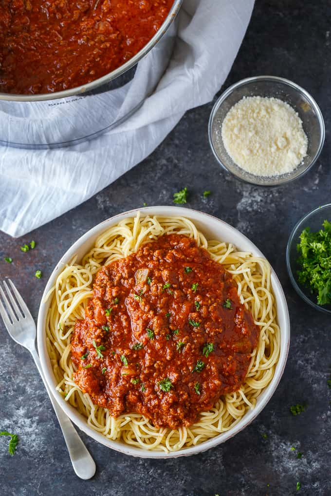 Homemade Spaghetti Sauce - This easy homemade sauce is filled with ground beef, tomatoes, onions, garlic, green peppers and spices. Made from scratch, it's one of the best pasta sauce recipes that everyone loves.