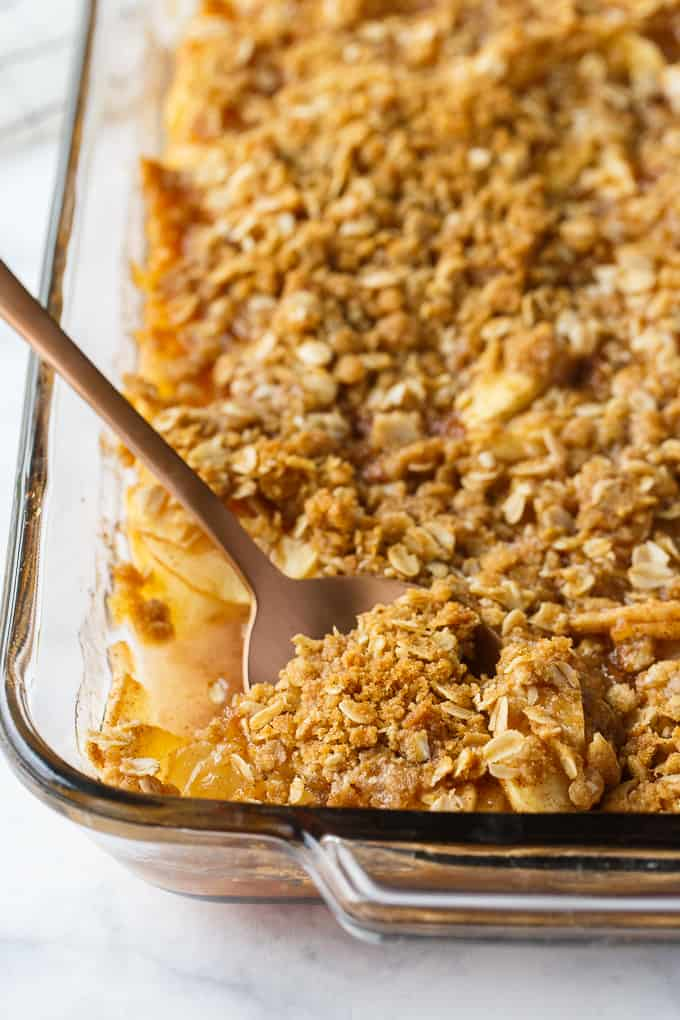 Apple Crisp - This simple old-fashioned dessert is baked with sweet and tart apples and topped with a brown sugar oat crumble. One of the best homemade fall desserts. Serve with vanilla ice cream for extra decadence.