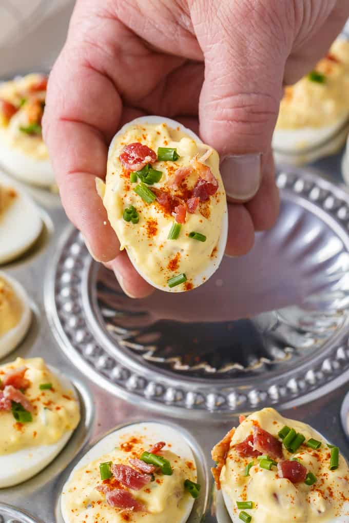 Bacon Ranch Deviled Eggs - A delicious savoury twist on classic deviled eggs! The filling is a divine mixture of creamy ranch dressing, bacon, Dijon mustard and chives.