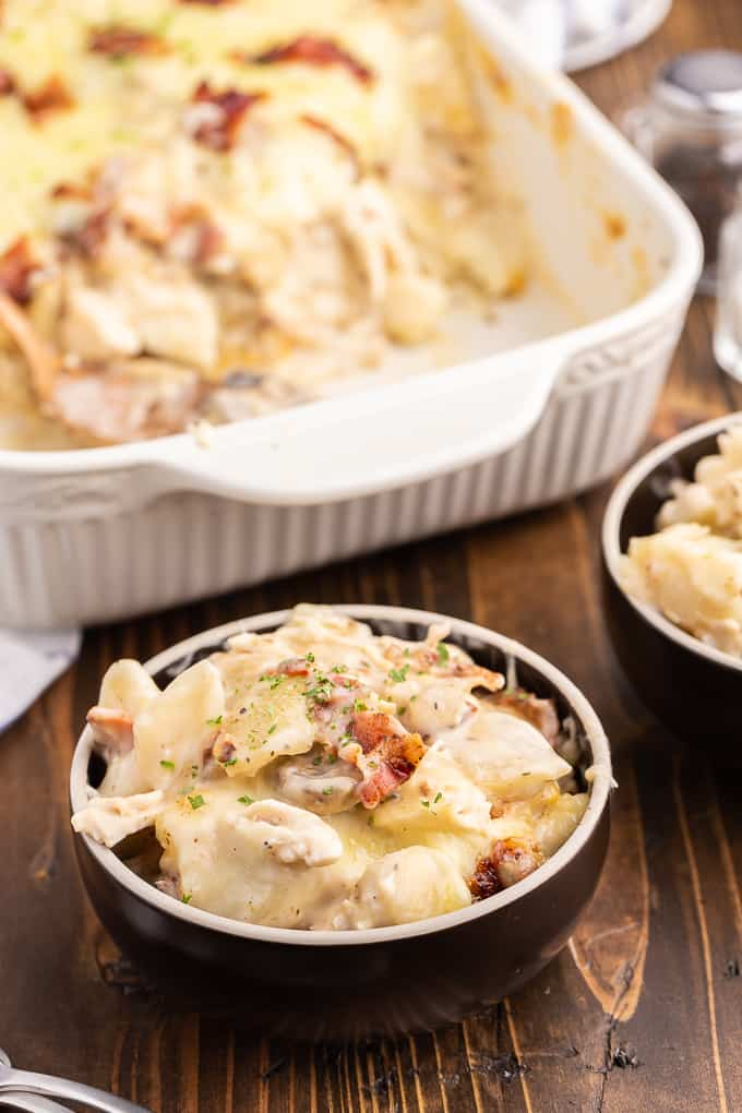Chicken Alfredo Pierogi Casserole - Everyone who tries this easy baked casserole made from frozen pierogies raves about how amazing it is! This comfort food dinner recipe is loaded with chicken, bacon, Alfredo sauce, onions, mushrooms and pierogies.