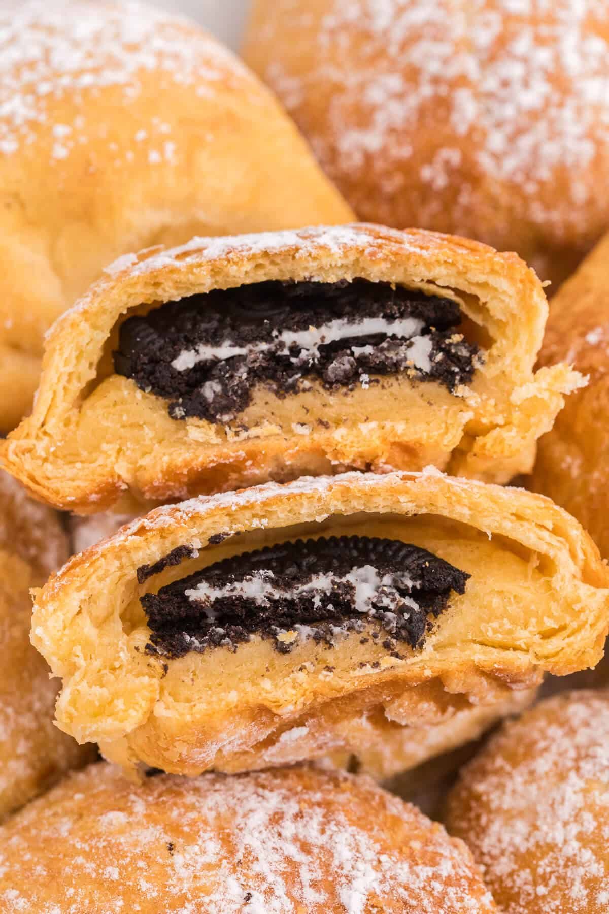 Air Fryer Oreos with Crescent Rolls - An easy and fun carnival treat made in the air fryer with crescent roll dough. Oreo cookies are enveloped in a sweet and golden crescent roll packet and topped with powdered sugar. Ready to eat in under 15 minutes!