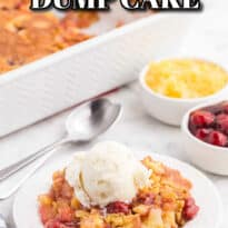 cherry pineapple dump cake topped with vanilla ice cream on a white plate