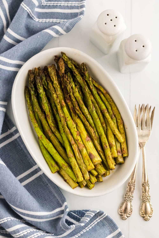 Asparagus in a white casserole dish