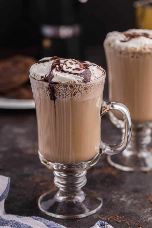 A glass mug of mocha latte