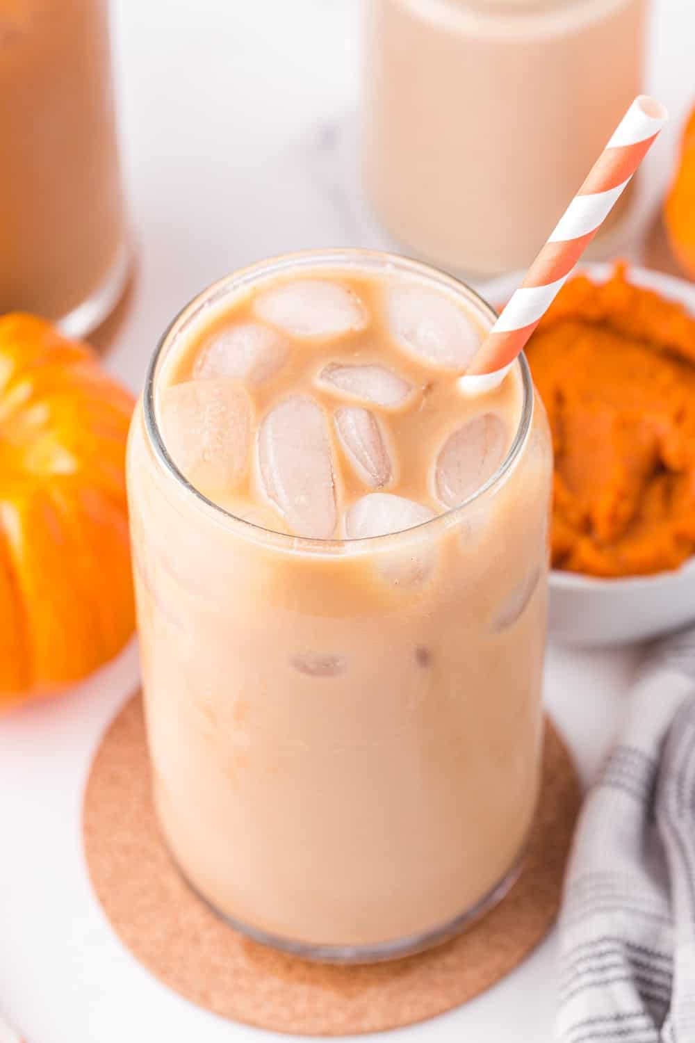 iced coffee with pumpkin spice creamer in a jar