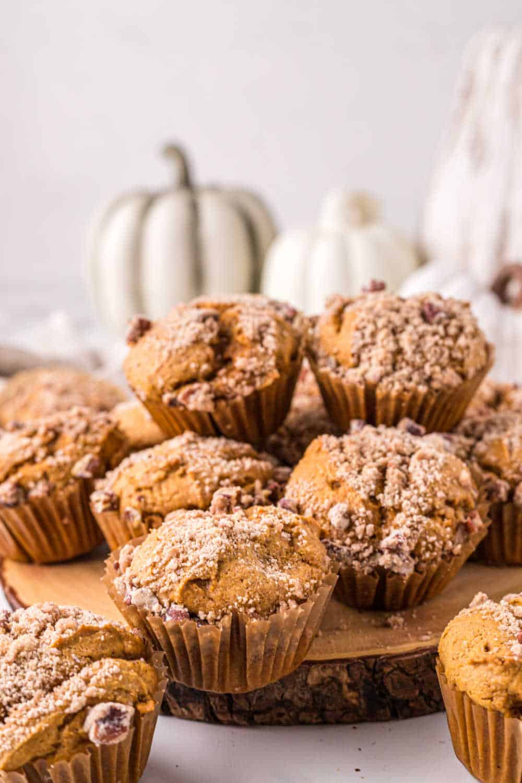 pumpkin crumb muffins on a wood platter