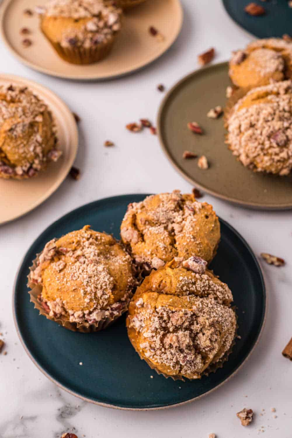 Pumpkin crumb muffins on colored plates