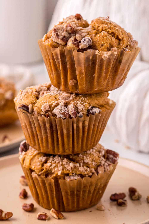 A stack of 3 pumpkin crumb muffins