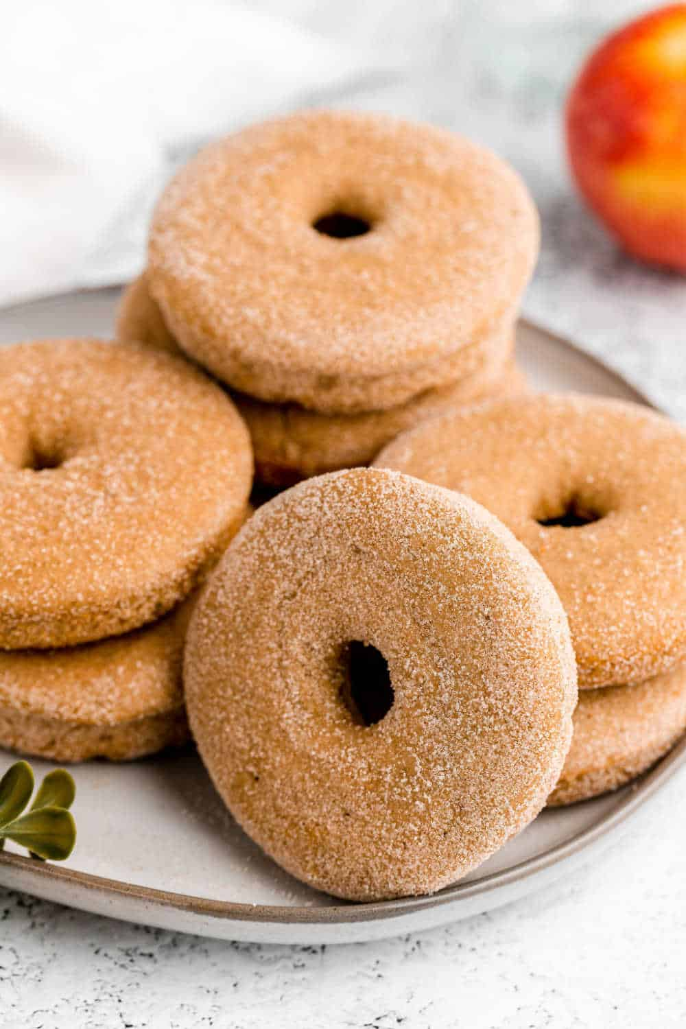 baked apple cider donuts on a plate