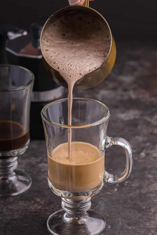 pouring the cream portion into the mug
